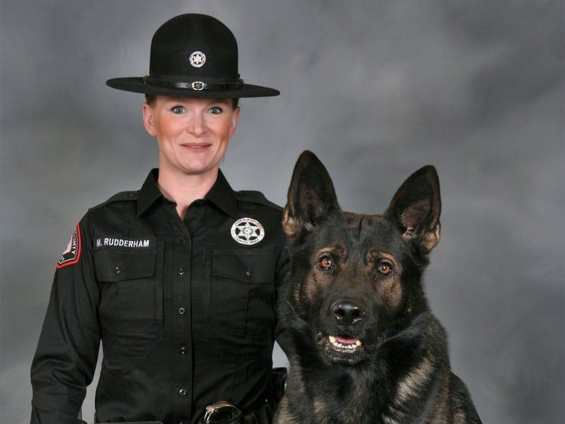 Deputy Morgan Rudderham poses with her K9 partner Athos.