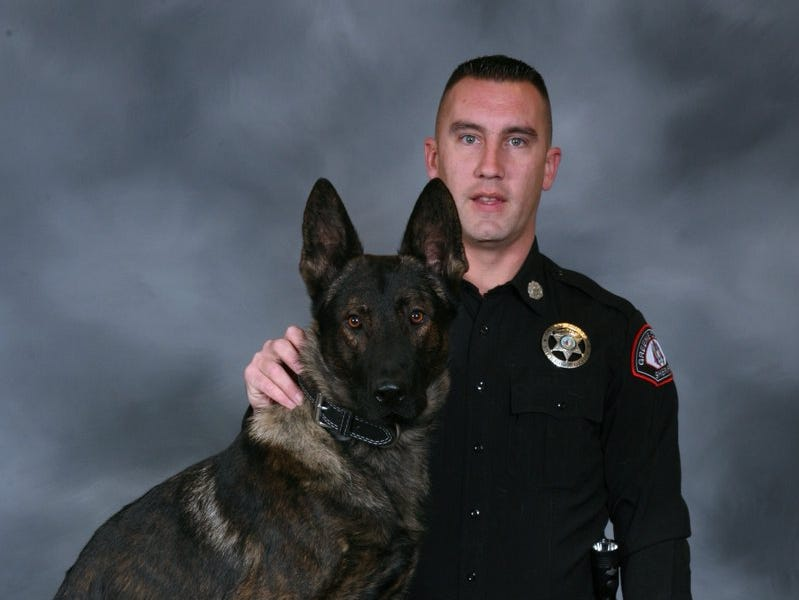 Deputy Tommy Connell poses with his K9 partner Creed.