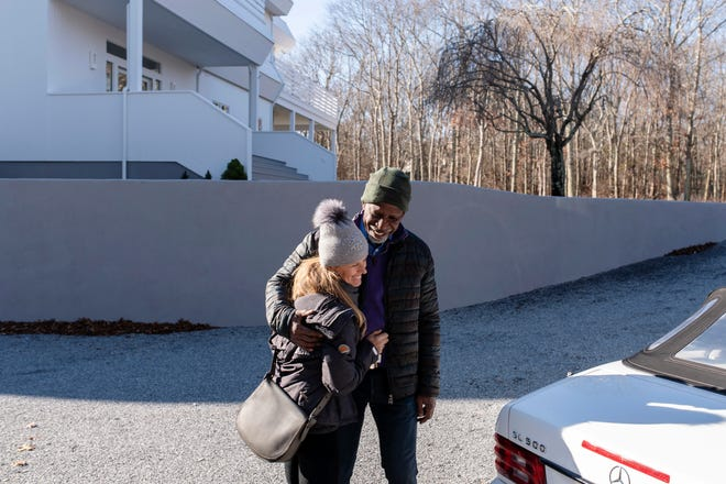 """Dan Gasby, right, and Alex Lerner embrace as they leave his East Hampton home. """"I didn't want to go out with a married man,"""" Alex said. Then he asked her to meet B."""