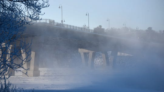 Steam from open water on the Mississippi River nearly obscures the Sauk Rapids Bridge as morning temperatures in the minus 30 range blanketed the area Wednesday, Jan. 30.