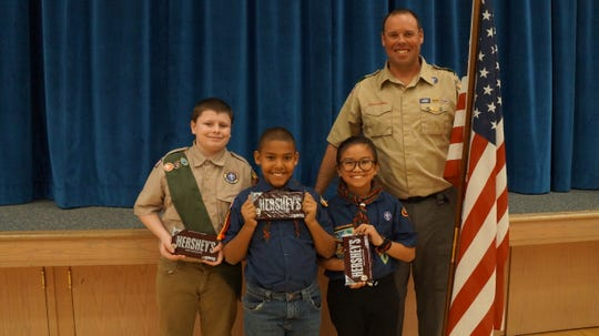 James Bourne, Dominic Bourne and Vicktor Cu with Virgin River Valley BSA district chairman Brian Haviland at the annual Scout Leader Recognition Dinner.