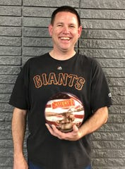 Russ Harkins poses with his custom bowling ball after rolling a 764 series at Dixie Bowl last week.