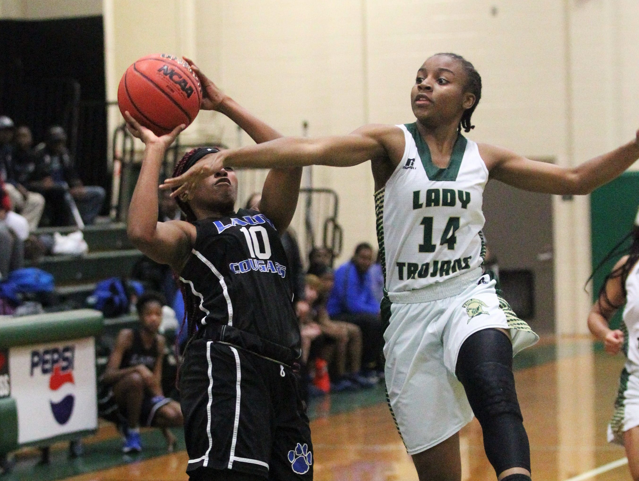 Godby's Kiara Byrd has her shot disrupted by Lincoln's Tariah Mosley as Lincoln's girls basketball team beat Godby 67-32 on Jan. 29, 2019.