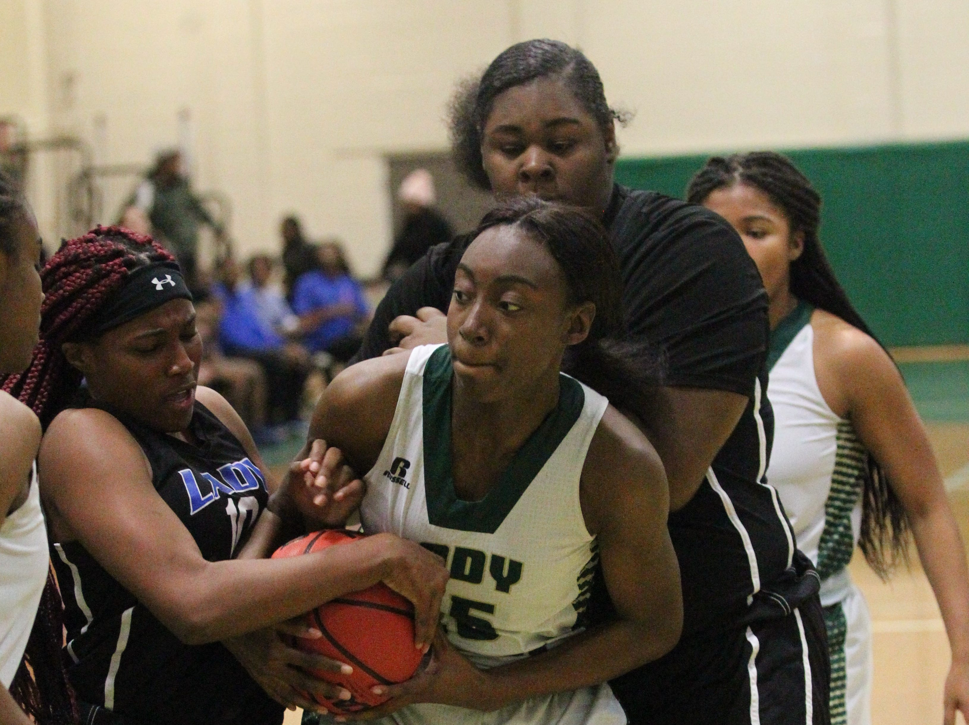 Lincoln's Ziare Reynold grabs a rebound but s tied up by Godby's Kiara Byrd as Lincoln's girls basketball team beat Godby 67-32 on Jan. 29, 2019.