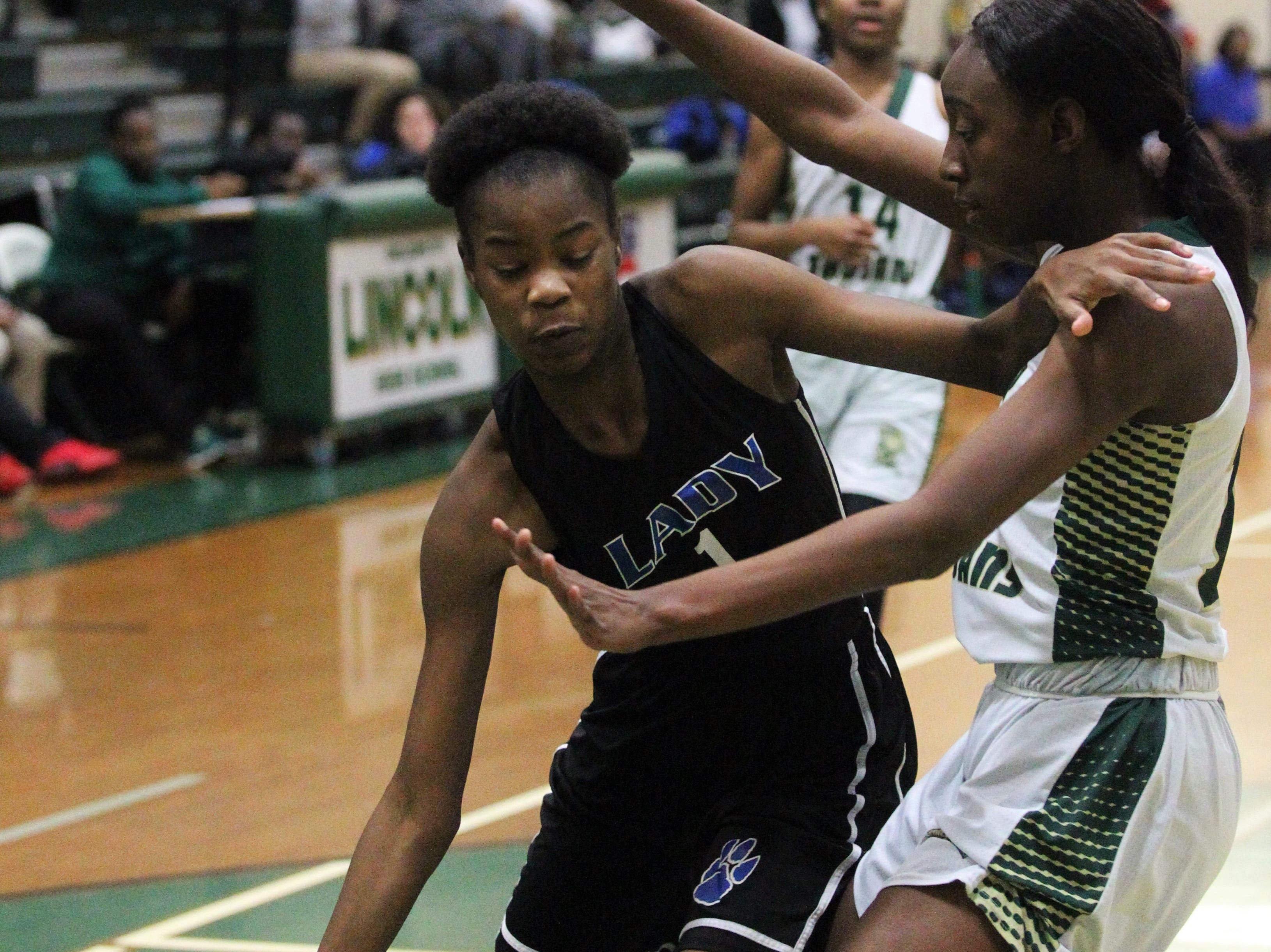 Godby's Imya Allen tries to get past Lincoln's Ziare Reynolds as Lincoln's girls basketball team beat Godby 67-32 on Jan. 29, 2019.