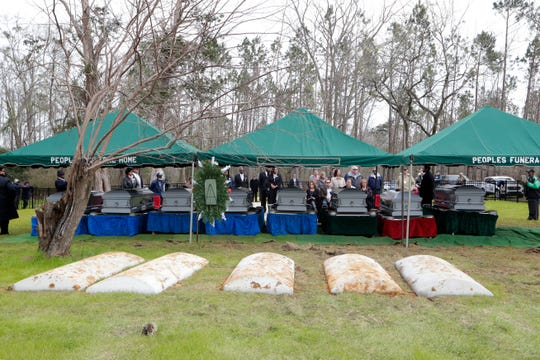 A service is held for family and friends of the eight victims who died during the fire at Dozier School for Boys in Marianna, Fla. in 1914, are in their final resting place at Boot Hill Cemetery on Wednesday, Jan. 30, 2019. The bodies were exhumed by a University of South Florida anthropologist over four years ago.