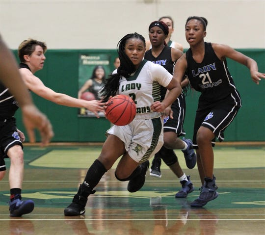 Lincoln sophomore guard Erin Turral dribbles up court on the way to scoring 33 of her 41 points in the first half of a 67-32 win over Godby on Jan. 29, 2019.