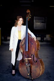 Bluegrass bass player Missy Raines is often compared to Lucinda Williams.