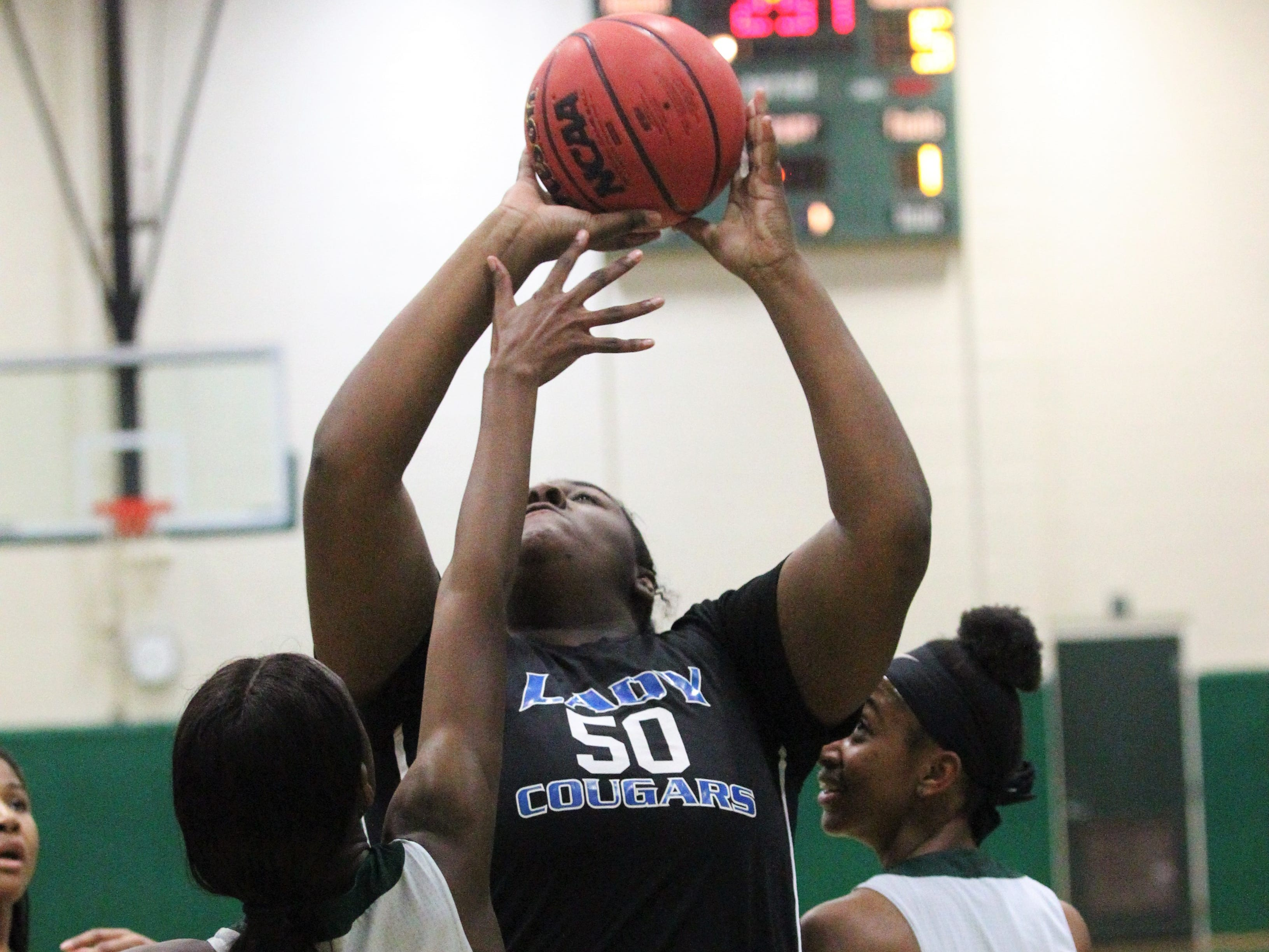 Godby's Keyziyah Spivey-Simms grabs a rebound and goes for a putback as Lincoln's girls basketball team beat Godby 67-32 on Jan. 29, 2019.
