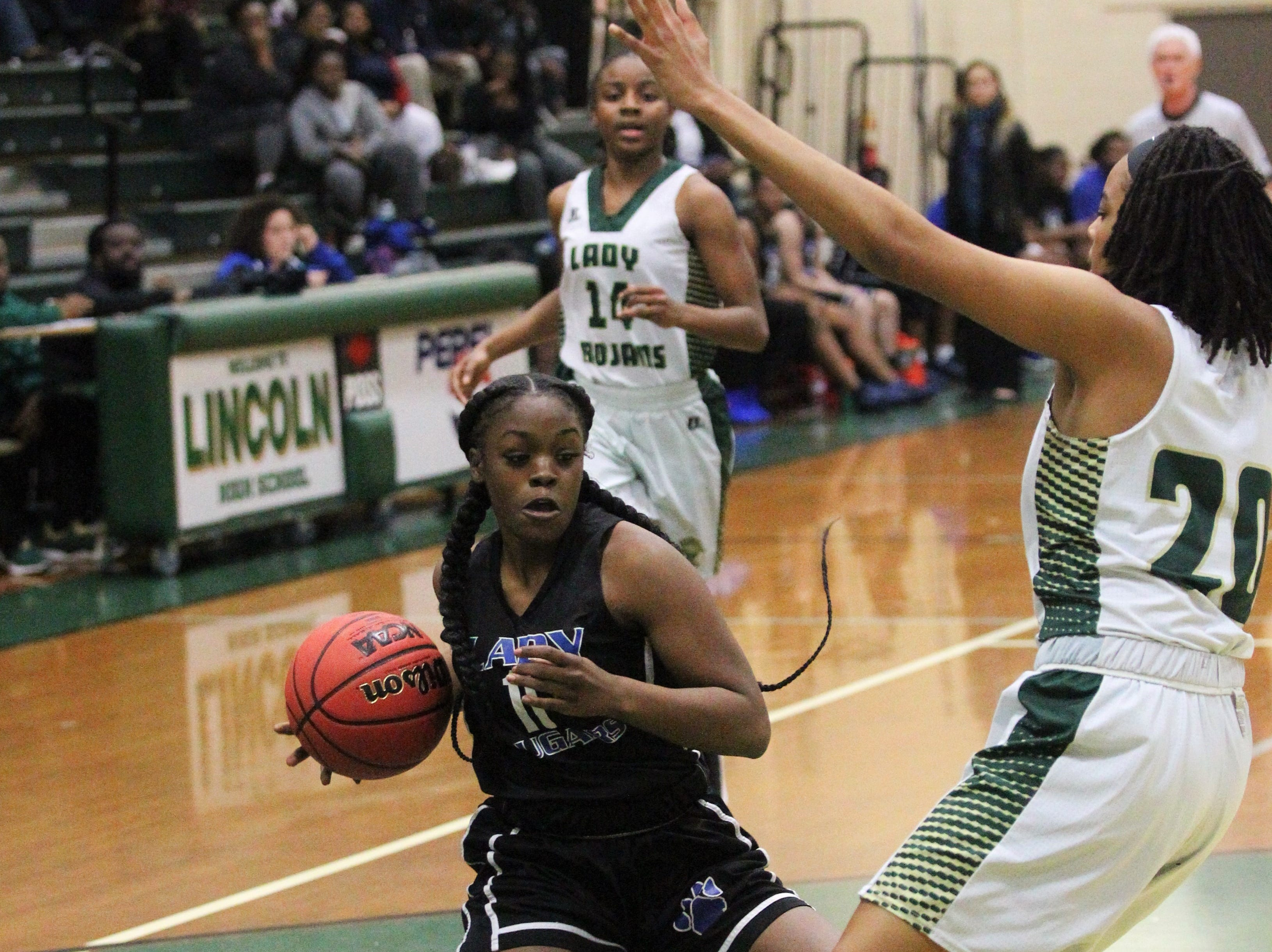 Godby's Akenke Chambers tries to get past Lincoln's Brooklyn Ware as Lincoln's girls basketball team beat Godby 67-32 on Jan. 29, 2019.