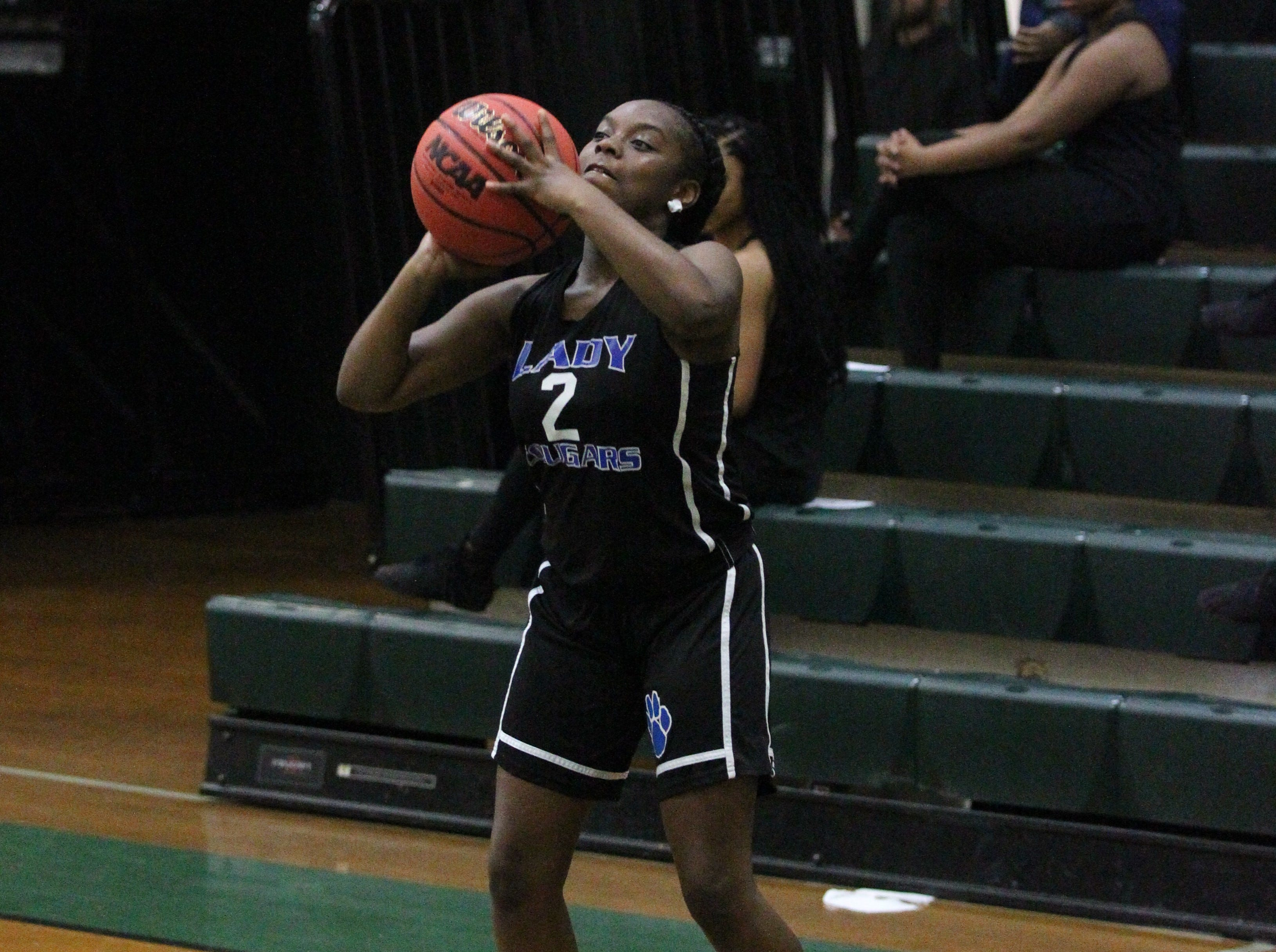 Godby's Kimaniy Dorsey takes a3 -pointer as Lincoln's girls basketball team beat Godby 67-32 on Jan. 29, 2019.