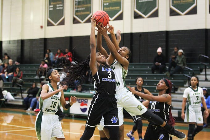Godby's Essence Nobles and Lincoln's Tariah Mosley fight for a rebound as Lincoln's girls basketball team beat Godby 67-32 on Jan. 29, 2019.