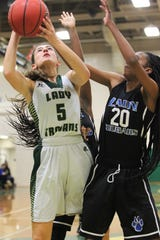 Lincoln's Kailey Schuchts grabs a rebound and tries to go back up as Lincoln's girls basketball team beat Godby 67-32 on Jan. 29, 2019.