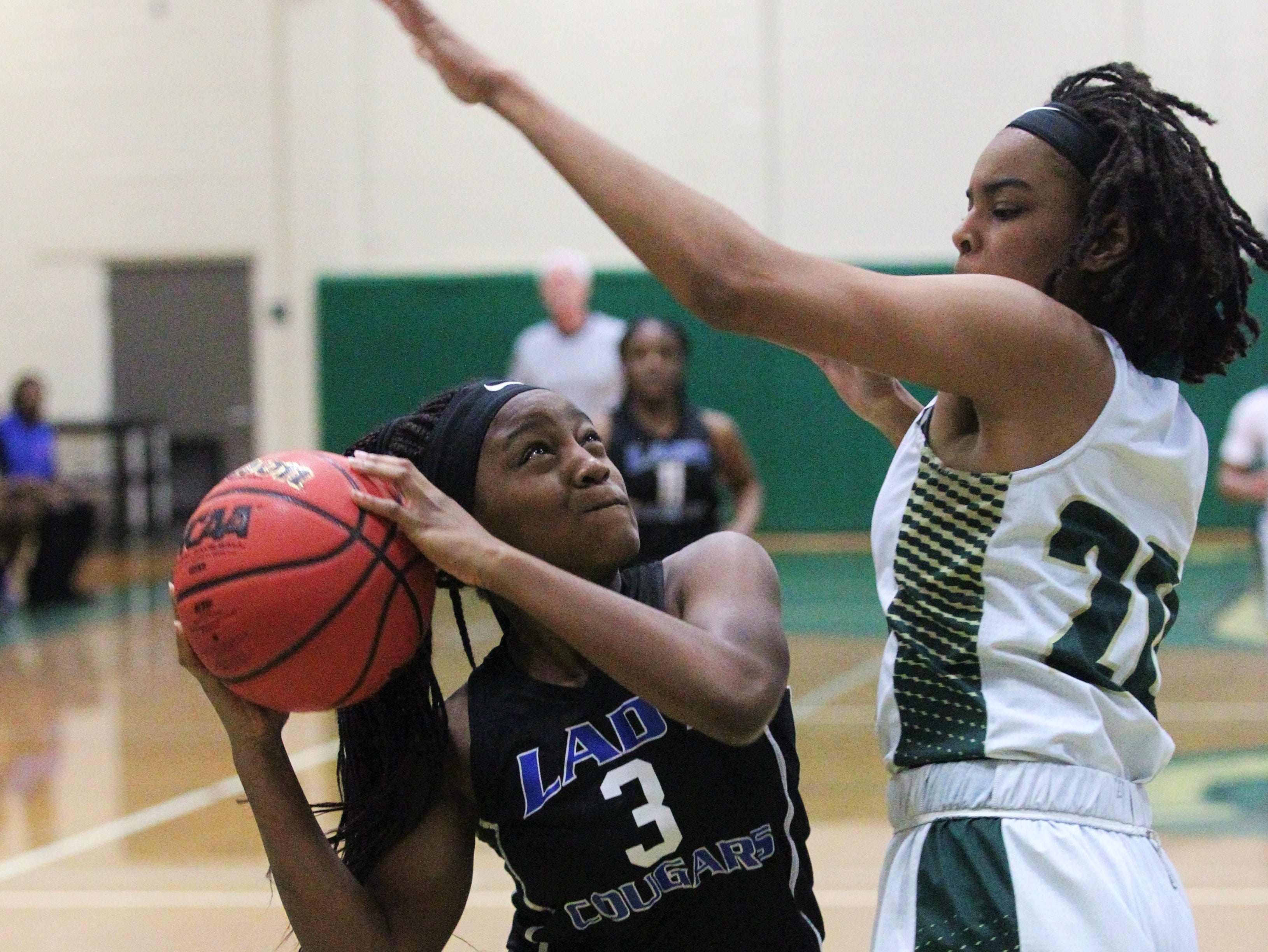 Godby's Essence Nobles tries to get a shot off over Lincoln's Brooklyn Ware as Lincoln's girls basketball team beat Godby 67-32 on Jan. 29, 2019.