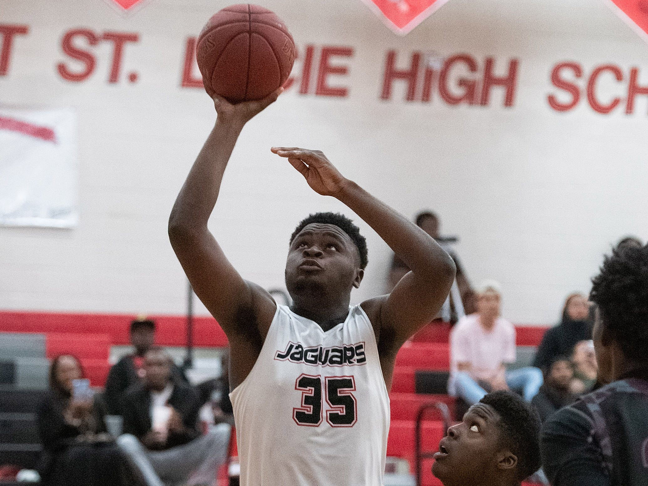 Port St. Lucie's Daniel King puts a shot past Fort Pierce Westwood's defense in the second half of their game at Port St. Lucie High School on Tuesday, Jan. 29, 2019, in Port St. Lucie.