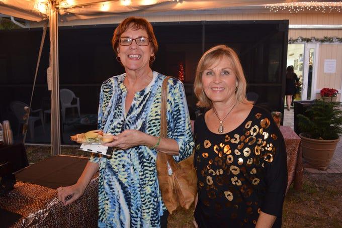 "Virginia Sherlock and Karen Bullock enjoying the ""Merry Meows"" festivities at Caring Fields Felines in Palm City."
