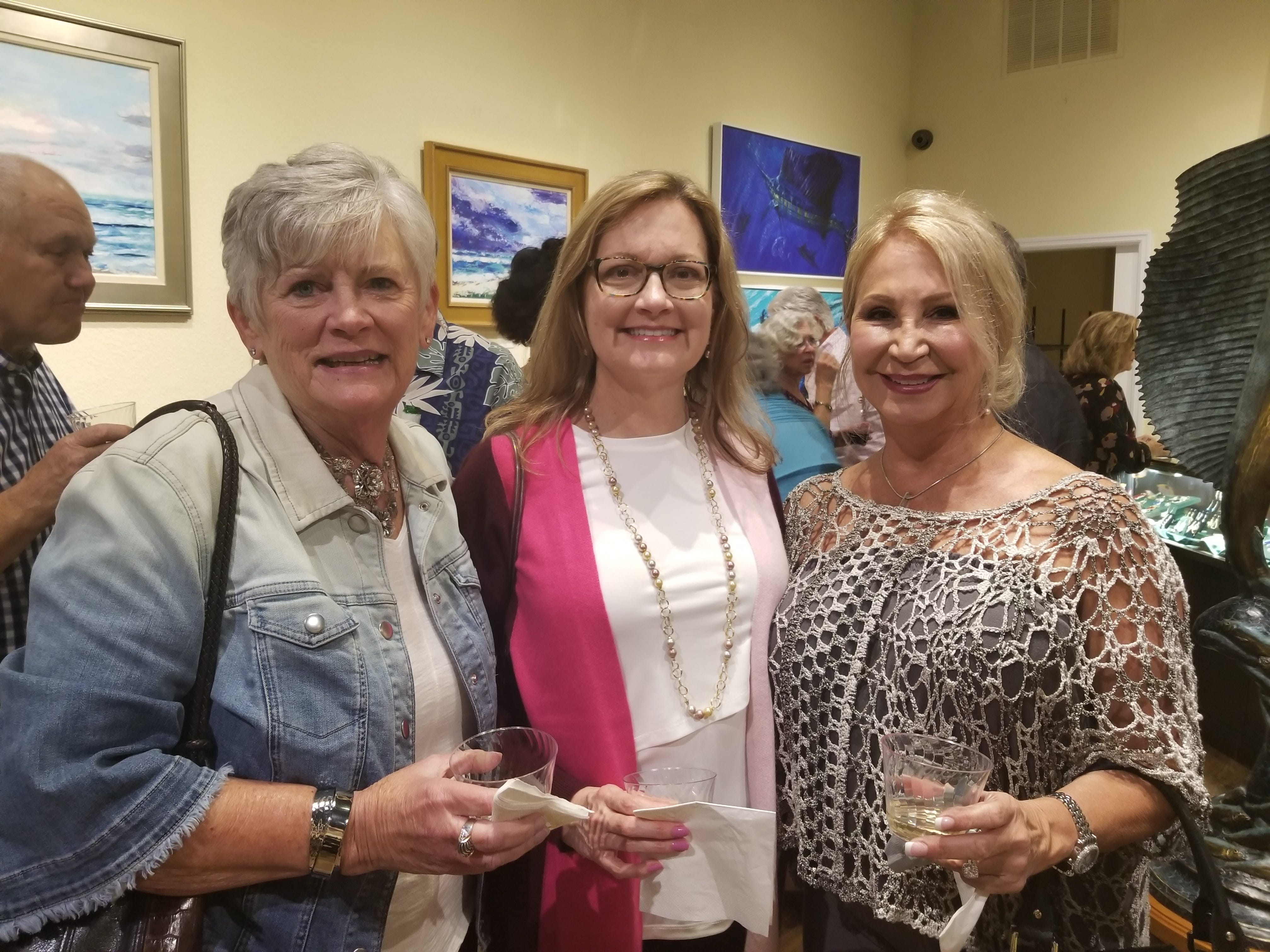Tykes & Teens partnered with Stuart'sLyric Theatre and Geoffrey Smith Gallery to host a rocking evening of fun for Tykes & Teens supporters. Pictured are Linda Arnold, left, Mary Fields and Reina Bianchi.