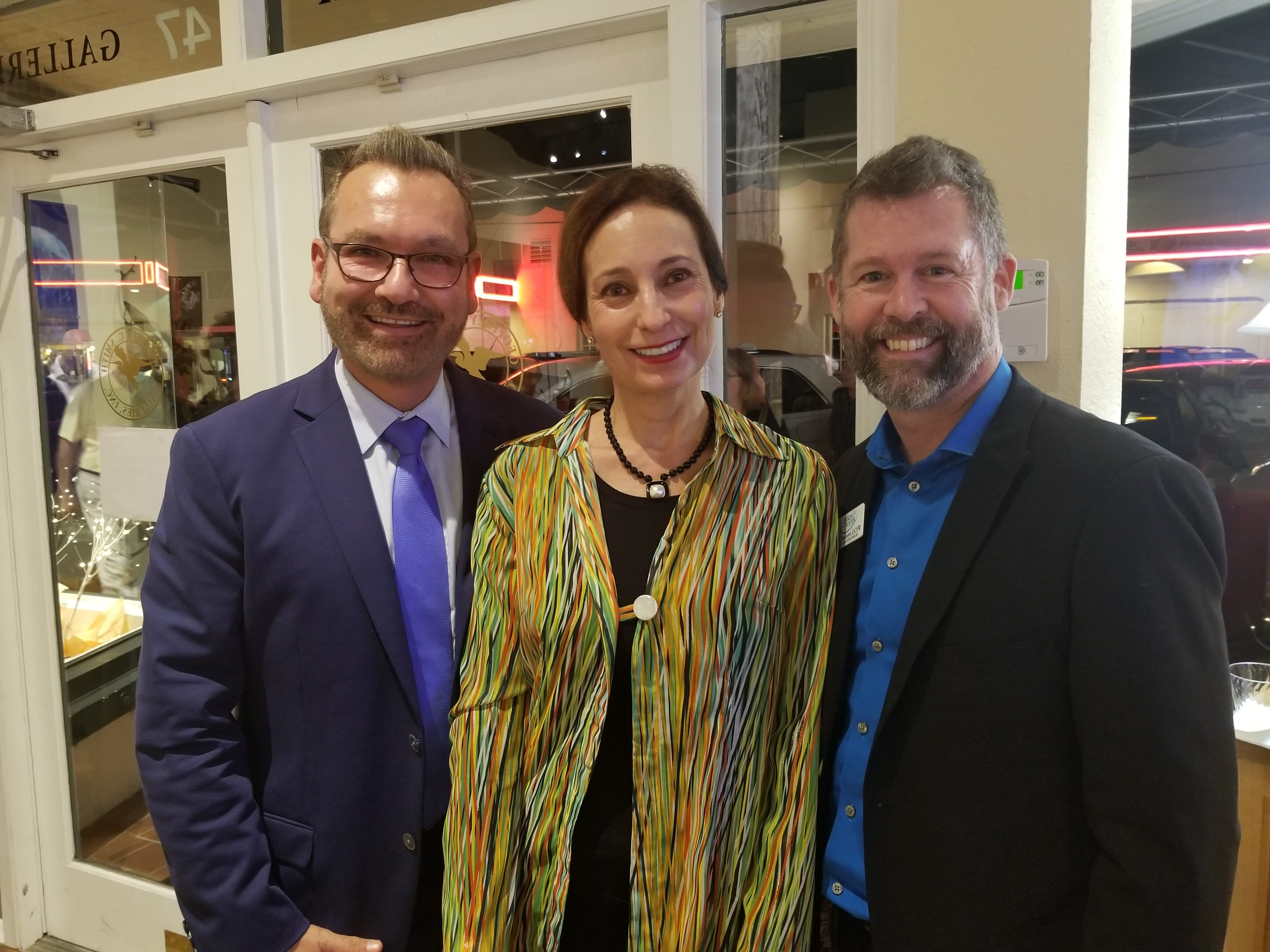 """Rudy Molinet, left, Rebecca Phillips and Jeff Shearer at Geoffrey Smith Gallery before a performance of the smash Vegas hit """"The Bronx Wanderers"""" at Stuart's Lyric Theatre. Tykes & Teens partnered with theLyric Theatre and Geoffrey Smith Gallery to host a rocking evening of fun for Tykes & Teens supporters."""