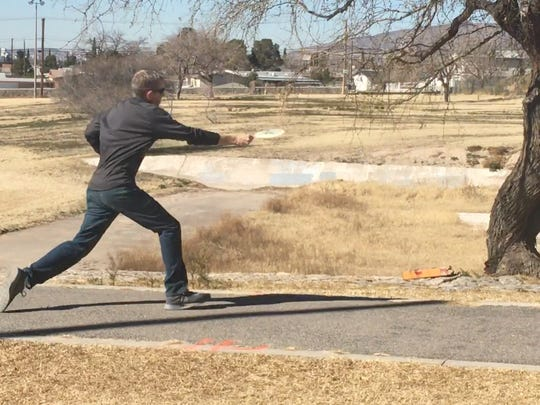Mike Norris tees off on the second hole of disc golf at Lionel Forti Park