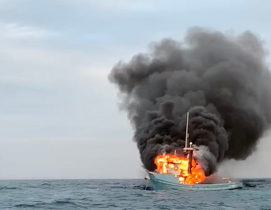 A good Samaritan rescued a person who was on a 50-foot boat that caught fire Tuesday off the coast of Oxnard, officials said.
