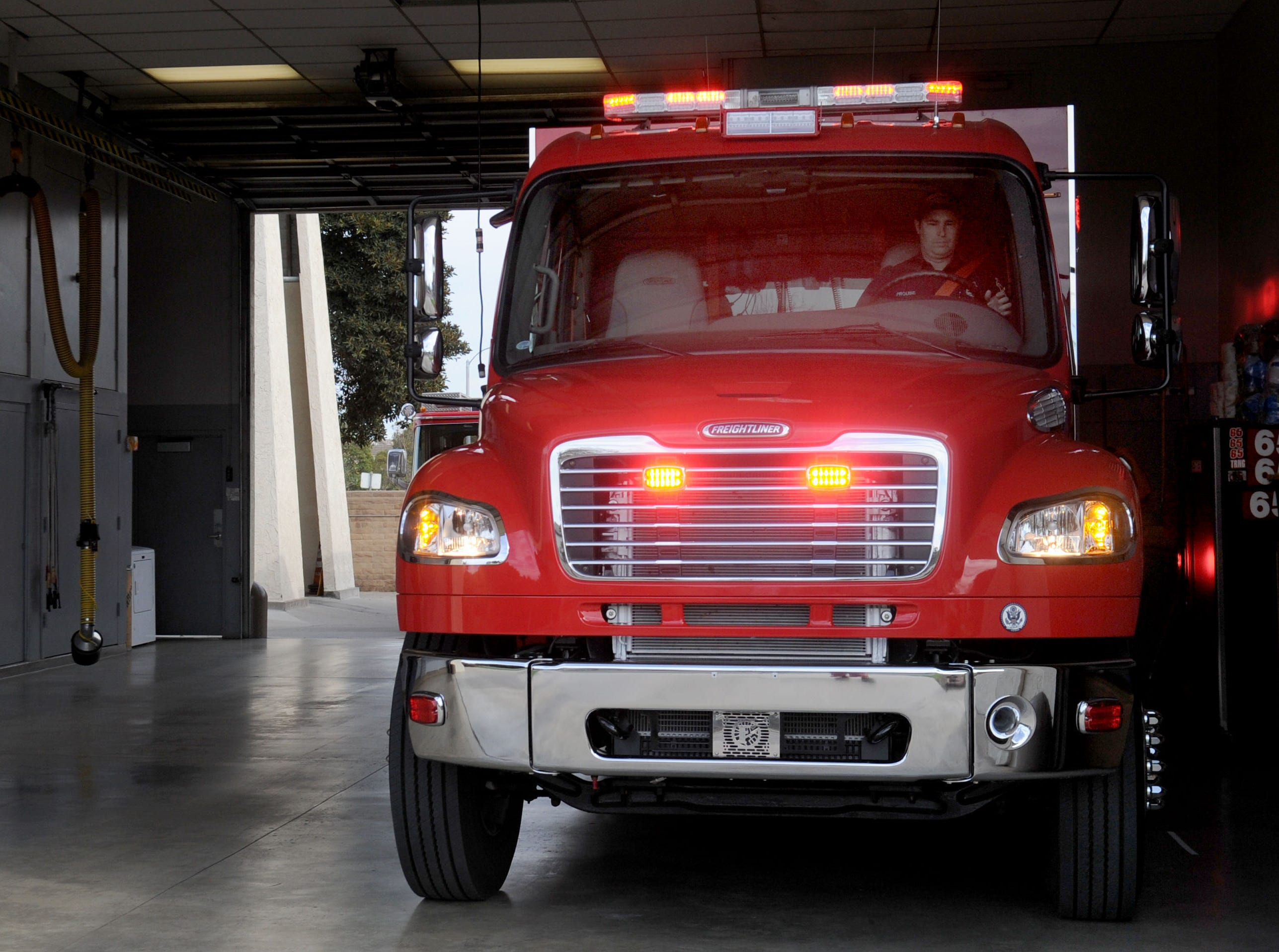Oxnard firefighter Luke Yessner, left, and Capt. Tim Brown watch as the city's new unit, Light and Air 65, is parked at Fire Station No. 5, 1450 Colonia Road.