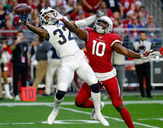 Rams cornerback Troy Hill (32) breaks up a pass intended for the Cardinals' Chad Williams during a game on Dec. 23. The St. Bonaventure High graduate will be playing in his first Super Bowl on Sunday.
