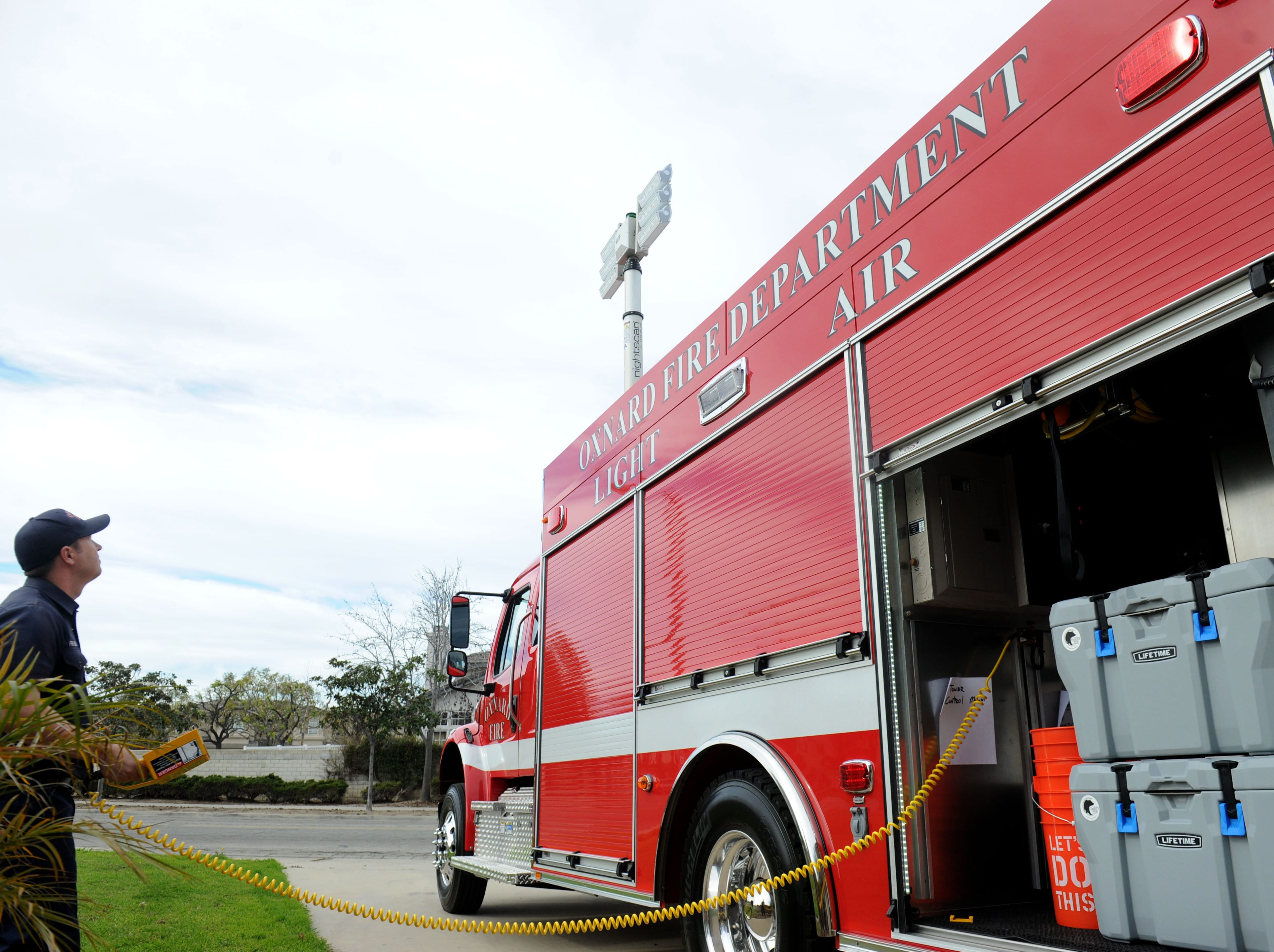 Oxnard Fire Department engineer Brian Prouse raises the lights of the city's new unit, Light and Air 65. The unit refills used air cylinders but also provides bright lighting for nighttime operations.
