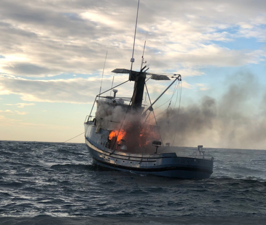 A good Samaritan rescued a person on a 50-foot boat that caught fire Tuesday off the coast of Oxnard, officials said.