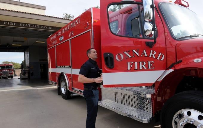 Oxnard firefighter Luke Yessner checks out the city's new unit, Light and Air 65,  at Fire Station No. 5, 1450 Colonia Road. The $450,000 truck, funded by a Federal Emergency Management Agency grant, will allow firefighters to refill their air tanks on demand.