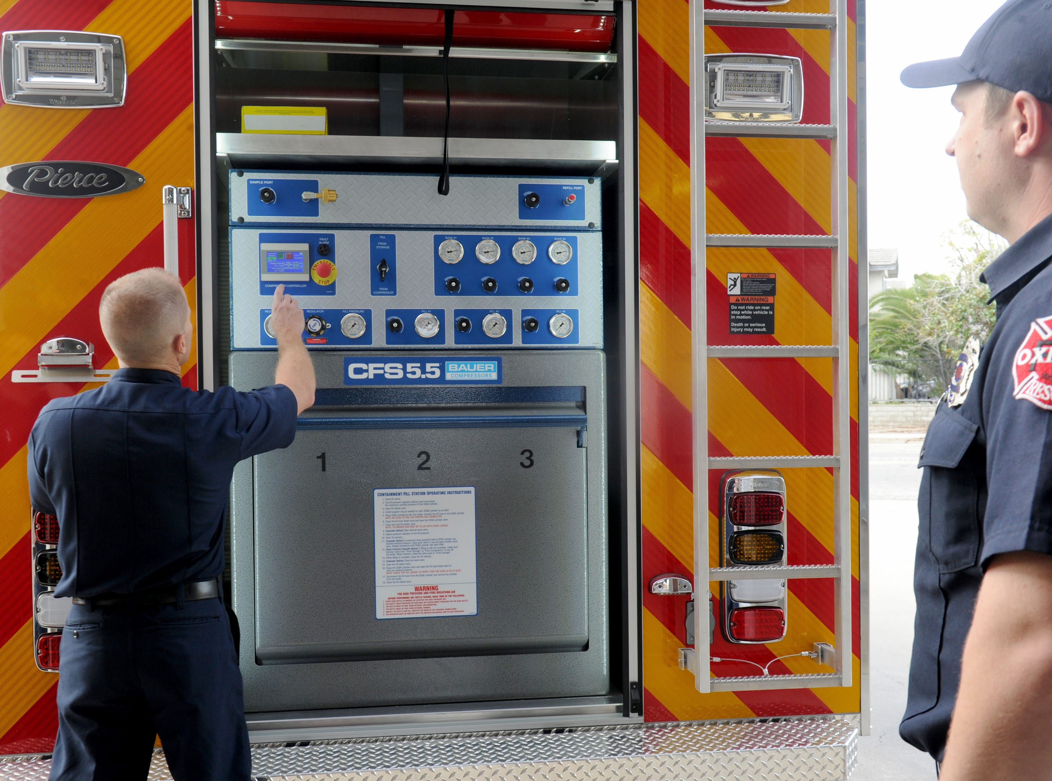 Oxnard Fire Department Capt. Tim Brown, left, and firefighter Luke Yessner check out the city's new Light and Air 65 parked at Station No. 5, 1450 Colonia Road.