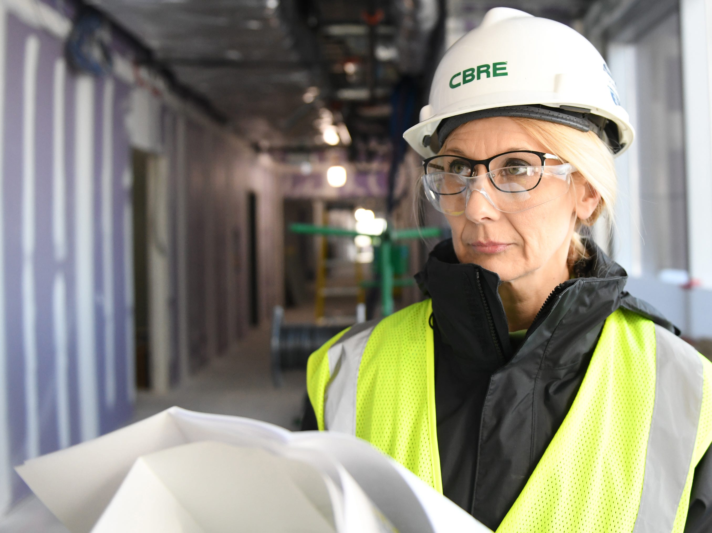 Tammy Hardin, one of the senior project managers at the Inspira Medical Center Mullica Hill construction site, watches as work continues on the facility.