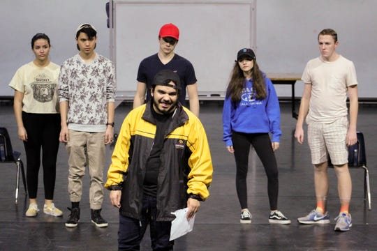"The cast of ""Columbinus"" rehearse a scene at the College of the Sequoia's Theatre. The play takes a documentary-like look at the Columbine High School massacre."