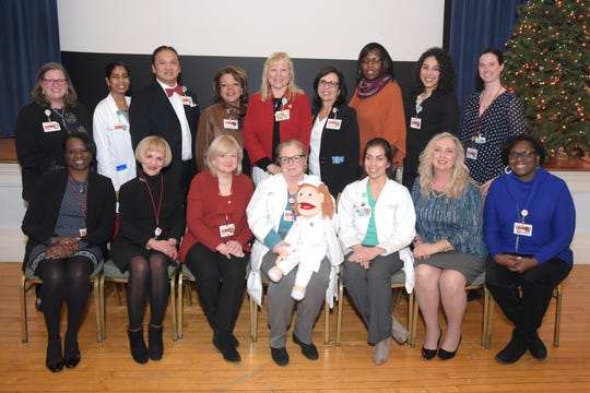 Linda Espinosa, MS, RN, NEA-BC (fourth from left, top row) with members of the nursing team at New York-Presbyterian