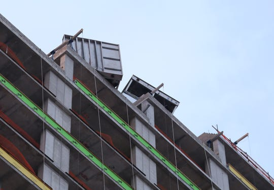 Yonkers firefighters work to secure two 5000 pound boxes on the 24th and 25th floor of an apartment building under construction near Warburton Avenue and Main Street in Yonkers, Jan. 30, 2019.