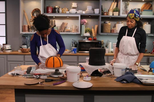 """Amarachi Onwumelu, left, and her cousin Ifey Okeya cut white fondant for details in the competition show, """"Bake it Like Buddy."""""""