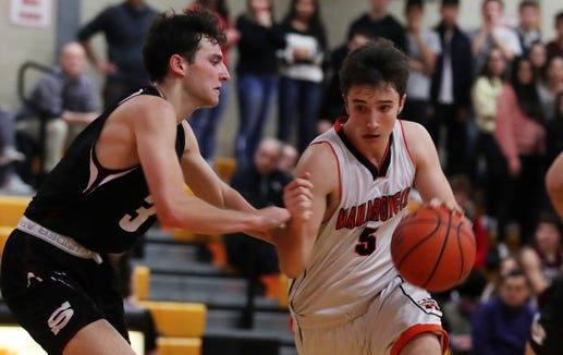 Mamaroneck's Gavin Zinghini (5) drives to the basket in front of Scarsdale's Eitan Altman (3) during boys basketball action at Mamaroneck High School Jan. 29, 2019. Mamaroneck won the game 58-53.