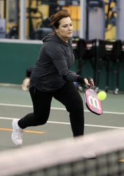 Rosalba Pesce of Yorktown returns the ball while playing pickleball at Solaris Sports Club in Yorktown Jan. 29 2019. Pickleball is a racquet sport that combines parts of tennis, badminton and ping pong.