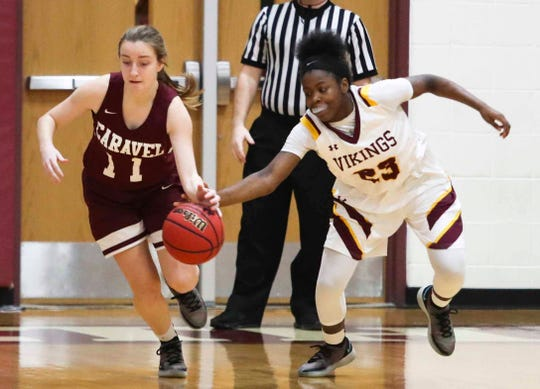 St. Elizabeth's Ber'Nyah Ward-Mayo (right) tries to poke the ball away from Caravel's Miranda Porretta on Jan. 29. St. Elizabeth has earned the No. 1 seed in the DIAA Girls Basketball Tournament.
