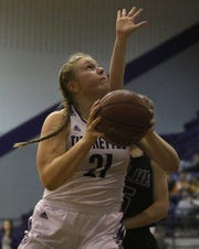 Jacksboro's Baylee Thompson drives to the basket against Tolar Tuesday, Jan. 29, 2019, in Jacksboro. The Lady Tigers defeated the Lady Rattlers 53-37.