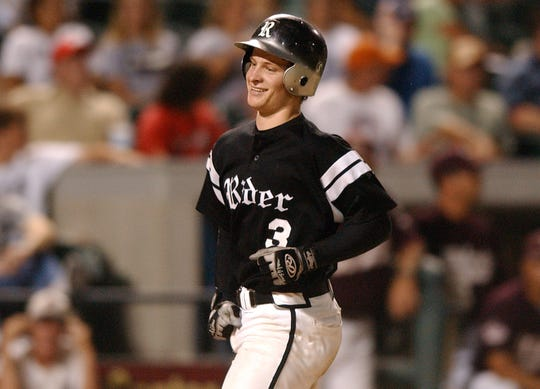 Rider's Ryan Brasier smiles after hitting a home run in the 2005 Class 4A state semifinal.