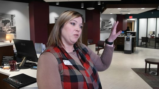Leslie Rhodes, branch relations manager for Texoma Community Credit Union, talks about the new downtown branch that opened this week in the lobby of the City National Building at 8th Street and Scott.