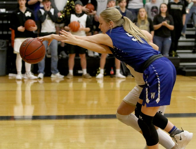 Windthorst's Grace Hoegger reaches for the ball as it goes out of bounds in the game against Archer City Tuesday, Jan. 29, 2019, in Archer City. The Trojanetts defeated the Lady Cats 44-40.