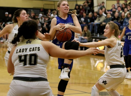 Windthorst's Kora Pennartz drives to the basket in the game against Archer City Tuesday, Jan. 29, 2019, in Archer City. The Trojanetts defeated the Lady Cats 44-40.
