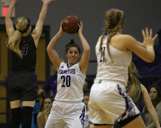 Jacksboro's Leah Plaster passes by Tolar's Grace Jones Tuesday, Jan. 29, 2019, in Jacksboro. The Lady Tigers defeated the Lady Rattlers 53-37.