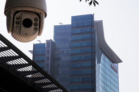 A surveillance camera is mounted near the Huawei headquarters in Shenzhen in south China's Guangdong province. The U.S. Justice Department unsealed criminal charges Monday, Jan. 28, 2019 against Chinese tech giant Huawei, a top company executive and several subsidiaries, alleging the company stole trade secrets, misled banks about its business and violated U.S. sanctions.