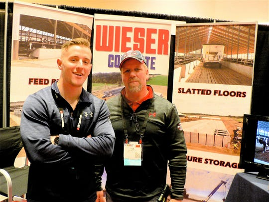 Cody Wieser (left) and Dan McKinney of Wieser Concrete,  say their company is diversified and builds many different concrete structures in addition to dairy buildings.
