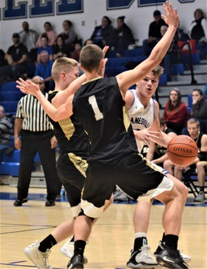 Zanesville's Clayton Foreman is cut off by two River View defenders, including Cal Shrimplin (No. 1), in the Blue Devils' 67-37 win on Tuesday.
