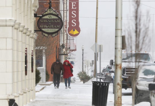 A pair of bundled pedestrians make their way down Fourth Street in Zanesville on Wednesday, braving a windchill well below 0. The National Weather Services is calling for a high 11 degrees at 4 p.m. Thursday, with winds up to 10 mph. However Sunday we may see a high of 50 degrees.