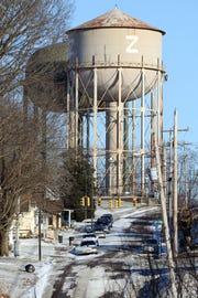 After building a new water tower (left) the demolition of the old water tower off Pine Street is part of the city of Zanesville's 2019 plans.