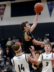 Keaton Williams goes in for a left-handed layup during Tri-Valley's win against Morgan last season. Williams is one of several returning letter winners for the Scotties, who enter with high expectations.